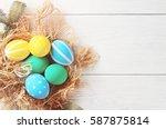 easter eggs on rustic white... | Shutterstock . vector #587875814