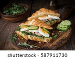 two croissant sandwiches with... | Shutterstock . vector #587911730