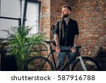 the bearded tattooed male... | Shutterstock . vector #587916788
