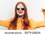 red haired woman in glasses