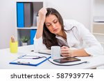 tired female doctor trying to... | Shutterstock . vector #587939774