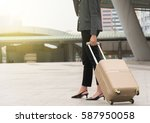 woman wearing a gray suit and... | Shutterstock . vector #587950058