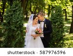 brunette bride and groom... | Shutterstock . vector #587976596