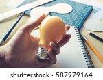 businessman with lightbulb on...   Shutterstock . vector #587979164