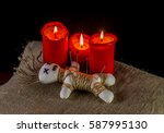 A Voodoo Doll And Candles Are...