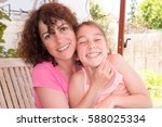 Small photo of mother and her accomplice daughter on the terrace of the house
