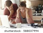young family with many debts... | Shutterstock . vector #588037994