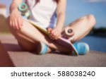 young girl sitting on a bank... | Shutterstock . vector #588038240