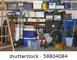 Overloaded suburban garage.  Boxes, coolers, sporting gear and more. - stock photo