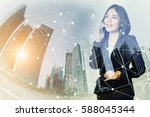 businesswoman using a mobile...   Shutterstock . vector #588045344