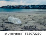 bottle plastic on stone ground... | Shutterstock . vector #588072290