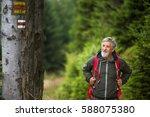 active senior hiking in high... | Shutterstock . vector #588075380
