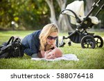 young woman with her newborn... | Shutterstock . vector #588076418