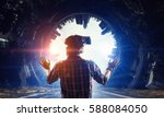 man in virtual helmet    .... | Shutterstock . vector #588084050
