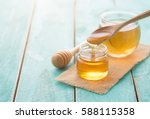 Honey With Wooden Honey Dipper...