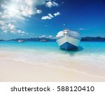 tropical beach with white sand... | Shutterstock . vector #588120410
