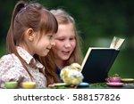 little girls playing outdoors....   Shutterstock . vector #588157826