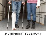 two persons with cast on on leg ... | Shutterstock . vector #588159044