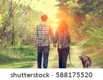 Happy Couple In Love With Dog...