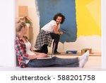 happy couple doing home... | Shutterstock . vector #588201758