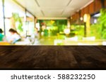 image of wooden table in front... | Shutterstock . vector #588232250