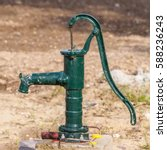 Green Rusty Manual Water Pump...
