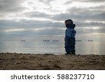 baby boy standing back and... | Shutterstock . vector #588237710