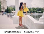beautiful young mother with ...   Shutterstock . vector #588263744