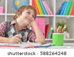 little boy  drawing with... | Shutterstock . vector #588264248