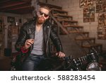handsome bearded man in leather ... | Shutterstock . vector #588283454