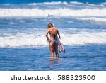 riding the waves. costa rica ... | Shutterstock . vector #588323900