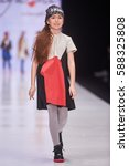 a model walks the runway on the ...   Shutterstock . vector #588325808