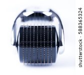 Small photo of Derma Roller on white, microneedle mesotherapy for skincare, rejuvenating treatment concept.