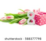 Small photo of Bouquet of tulips isolated on white background with a red doted gift box as a symbol of the holiday. Spring flowers. Greeting card for 8 March Woman's Day.