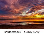 A Colorful Sunset Over An...