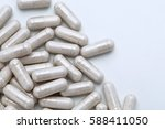 pile of capsules with probiotic ... | Shutterstock . vector #588411050