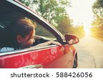 happy smiling woman in a car... | Shutterstock . vector #588426056