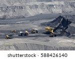 excavator  digging for brown... | Shutterstock . vector #588426140