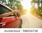 happy woman hand out window car ... | Shutterstock . vector #588426728