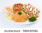 chicken shawerma with rice and... | Shutterstock . vector #588430586