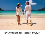 couple in white on a tropical... | Shutterstock . vector #588459224