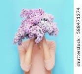 woman hiding head bouquet lilac ... | Shutterstock . vector #588471374