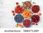 various fresh fruits in bowls... | Shutterstock . vector #588471389