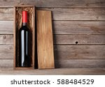 red wine bottle in box in front ... | Shutterstock . vector #588484529
