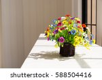 colorful flowers in brown wood... | Shutterstock . vector #588504416