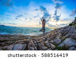 the woman practices yoga at... | Shutterstock . vector #588516419