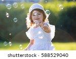 adorable little girl  has happy ...   Shutterstock . vector #588529040