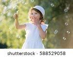 adorable little girl  has happy ... | Shutterstock . vector #588529058