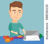 caucasian man following recipe... | Shutterstock .eps vector #588530120