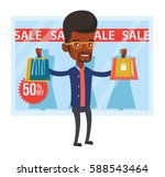 african man with shopping bags... | Shutterstock .eps vector #588543464